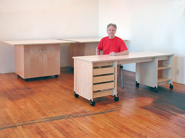 Rolling counter high natural maple work tables and rolling art studio desk with drawers are all made by Art Boards™ Art Supply in Brooklyn NY.