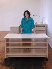 Art Studio Rolling work table has adjustable large art storage shelves and art studio desk.