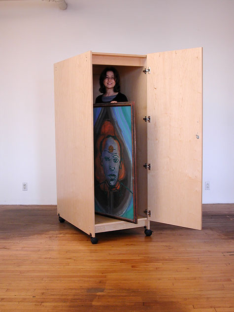 Art Storage Cabinet for storing art with wheels and locking door.