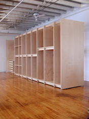 Art Storage System for the storage of fine art in an the art gallery has extra deep art storage shelves and drawers.