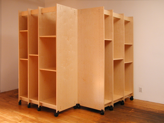 Art Storage Cabinet for storing art around an outside corner.