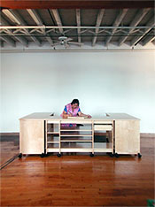 "Art Studio Furniture System by Art Boards™ rolled together to make 10'4"" art work desk."
