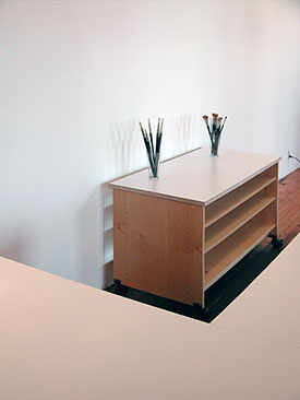 Extra large art storage shelves and work surface for the art studio.