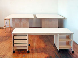 Rolling maple tables are beautiful with doors below for art storage.
