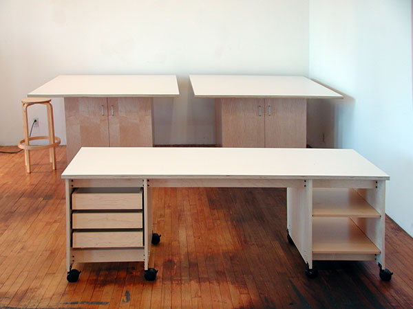 Attrayant Rolling Maple Tables Are Beautiful With Doors Below For Art Storage.