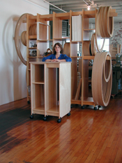 Art Storage for the art studio holds round and rectangular paintings.