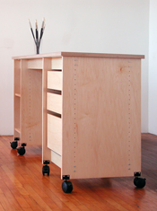 Art Storage Workstation is a Table & Desk with art storage drawers and shelves.