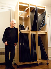 "Photographer William Loeb's self portrait leaning on his ""Art Storage System"""