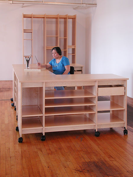 Art Studio desk with drawers and art storage shelves for storing art and art supplies.