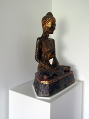 The 19th century Buddha sits on a custom lacquered sculpture pedestal.