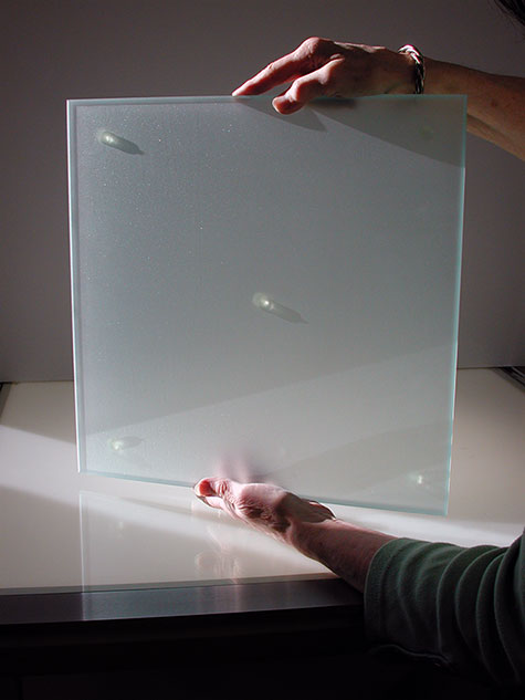 Solid Glass Grinding Surface is sandblasted for mixing dry pigments with a Glass Muller.