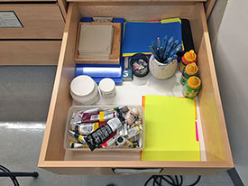 Pastel storage drawer has individual pastel trays for art students to use in class.