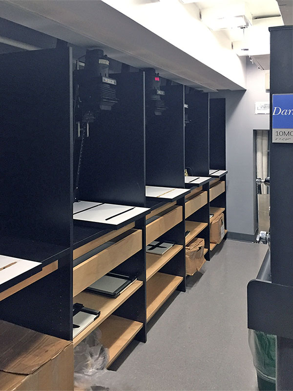 Darkroom photo work stations to enable creative photography students to better process analog photographic art printing.