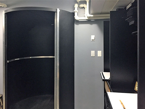 The rotary darkroom door is where the students whirl in from the busy light filled hallway to the tranquil peaceful realm of their photography art darkroom.