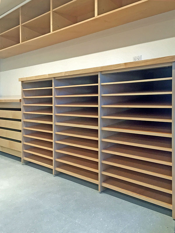 Photo Studio has 30 deep adjustable shelves for storing and organizing student photographic assignments.