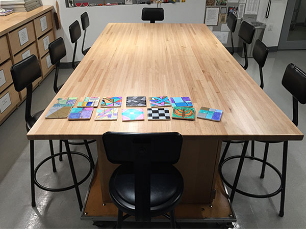 Art Boards™ Large Rolling Art Studio Work Table is 4 foot x 8 foot. The large butcher block top is versatile and can seat 10 individual art students comfortably.