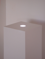 White lacquer sculpture pedestal  base with recessed adjustable lighting.