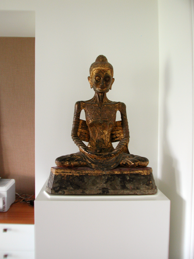 Sculpture Pedestal with a white lacquer finish for a bronze Buddha.