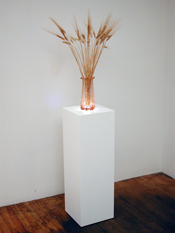White lacquer sculpture base with recessed under lighting.