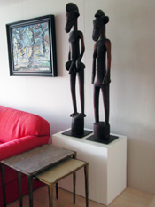 Art Boards™ Sculpture base holding Senufo Rhythm Pounder male and female figures from Africa.
