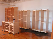 Art Storage Rack with shelving and artwork tables for making art and storing art.