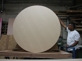 "Circular wood custom size art panel is 1.5"" thick by 60"" wide."